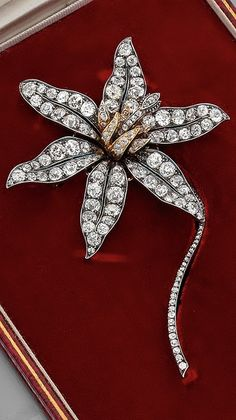 Collingwood attributed - An antique gold, silver and diamond brooch, 19th century. Designed as an orchid flower, mounted en tremblant in silver, set throughout with diamonds, the pistil in yellow gold. Numbered. #Collingwood #antique #brooch