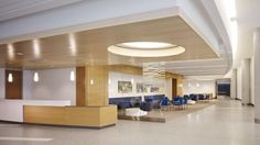 Different furniture and seating arrangements are provided in the diagnostic waiting area, while wood ceiling and wall panels serve as an accent throughout the space. Photo: Dave Burk ©Hedrich Blessing