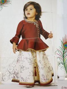 Maroon Palazzo/lehenga Designer Suit For Girls From Palkhi FashionPalkhi fashion exclusive maroon colored soft silk girls peplum style outfit with two different bottom, one printed skirt & one white palazzo. Baby Girl Dress Design, Girls Frock Design, Kids Dress Wear, Kids Gown, Kids Wear, Baby Girl Frocks, Frocks For Girls, Baby Frocks Designs, Kids Frocks Design