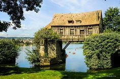 The Old Mill (Le Vieux-Moulin) in the commune of Vernon, in northern France, is a 16th century flour mill constructed on top of an ancient bridge that once spanned the Seine River.