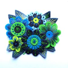 VINTAGE BOUQUET FELT BROOCH    MEASUREMENT 10cm by 7cm    MATERIALS  Felt  Embroidery cotton  Brooch pin    I pay close attention to detail and as