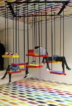 Rainbow brights and an unconventional swing set make for a whimsical window display at Chanel. WGSN store shot, Paris