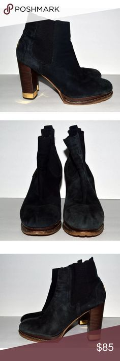 """Tory Burch 9 Suede Black Ankle Boots $350 Tory Burch round-toe ankle boots with stacked heels featuring gold-tone embellishment, rubber logo at counters and grosgrain gores at sides.  Heels: 4"""" Platforms: 1""""  CONDITION: General wear throughout.  Wear from use as pictured such as scuffing, marks, sole, and footbed wear, and hardware wear.  Waving to the elastic as pictured.  Fading to the black as pictured.  Please see all photos and use the zoom option to make a personal assessment of the…"""