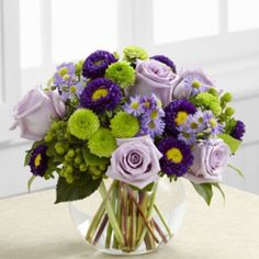 Table arrangement. With purple lisianthus instead of asters and chrysanths instead of roses