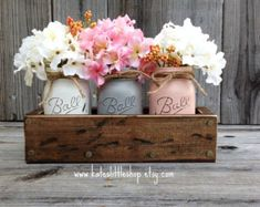 Add a gorgeous rustic planter box to your home, office or special event décor. This beautiful set is the perfect addition to your rustic or country décor, and can be customized with a choice of 2 different stains or white wash finish, as well as flower colors. The planter box is made of hand-picked, high quality white pine. Its natural knots add individual character and rustic appeal. Each box is sealed to give them lasting beauty. Check out our awesome customer reviews and sales for…