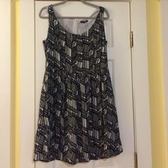 Black and white GAP dress. Black and white GAP dress.  Perfect for summer but also looks adorable with a chunky belt, tights and cardigan for the fall!! GAP Dresses