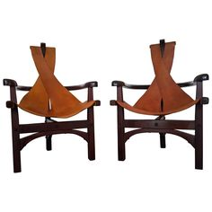 Pair of Three-Legged Arts and Crafts Slung Leather Lounge Chairs | From a unique collection of antique and modern chairs at https://www.1stdibs.com/furniture/seating/chairs/