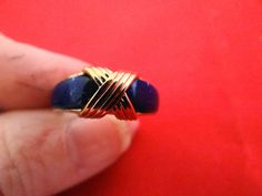 Vintage size 575 gold  ring with blue thermoset inset by jeanmc, $20.00