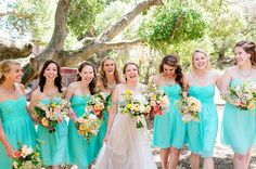 Bridesmaids in teal with statement necklaces