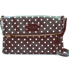 """Kate Spade Aleah Spot Cross Body BNWT. Never carried. Adorable and sporty. Its a great purse for hands free cross body wear. Luxury nylon exterior in black and cream, Kate Spade patent leather logo plate, light 14k gold plated hardware, snap flap closure. Interior has a Kate Spade signature cherry red satin interior  and one zip pocket. Has adjustable 22"""" patent leather strap. kate spade Bags Crossbody Bags"""