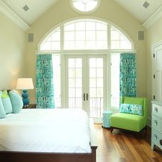Beautiful French doors open into this cheery bedroom with gorgeous patio doors with arched transom that opens onto a rod iron balcony!   www.franksglass.com