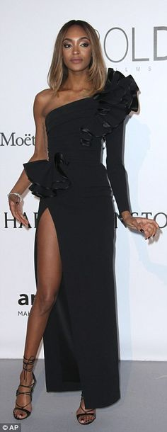 Looking good! Jourdan Dunn borrowed from the Eighties with a super retro gown boasting a d...