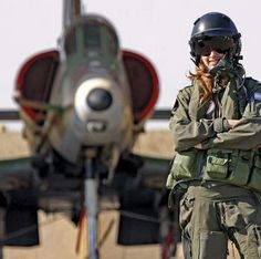 IDF pilot in front of American Skyhawk naval fighter.