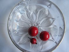 Poinsettia Glass Candy Dish $6.00 available at The Vintage Marketplace at Blue Thistle Paperie on Etsy!  Click here https://www.etsy.com/listing/212539721/poinsettia-glass-candy-or-nut-dish-with?ref=shop_home_active_1