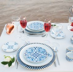 "Tips by Yolanda Noivo | noir et chocolat – Design of Ambiances  Some details of the designs and patterns of the ""Transatlântica"" dinner set. In the smaller pieces: marine motifs are applied inside. In the larger ones: a ""stamp"" with a caravel to mark the strong connection to the sea. The simple lines of the ""Light"" crystal pieces complete, in a sober but delicate fashion, this table that shines in the sunset."