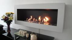 Bio Ethanol Fireplaces For Wall Mounted Applications . Come and find out how with a Wall Mounted Bio Ethanol Fireplace you can redecorate your home and at the same time save money on heating. Gel Fireplace, Wall Mounted Fireplace, Fireplace Inserts, Fireplace Design, Modern Fireplace, Biofuel Fireplace, Bioethanol Fireplace, Foyer Mural, Ideas