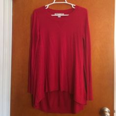 Red shirt with mesh back Very cute with leggings. Just doesn't fit me right. Tops Tees - Long Sleeve