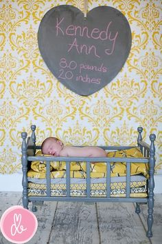 Love the used and reused crib  --adorable baby announcement idea. Paint wicker bassinet grey and add mattress layers