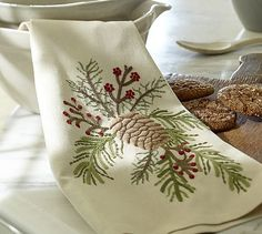 Embroidered Pinecone & Berry Kitchen Towel #potterybarn  Ok, so I have just about every Embroidery Library pinecone and berries, just need to stitch them up
