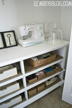 an old dresser turned into shelves for crafty things