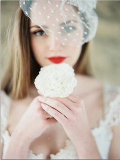 e6f768a0b285f Bridal portraits  bride smelling holding flower to face