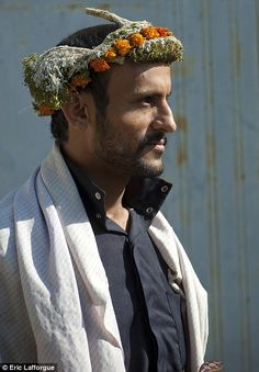 Striking: The men, who all live in a small village called Asir, were initially happy to tell Lafforgue about their garlands and pose for photos