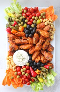 Wings Platter with Clean Blue Cheese Dressing Clean blue cheese dressing made with greek yogurt. Your wings and waistline will thank you!I've swapped out the usual sour cream with protein and probiotic packed greek yogurt for a rich and healthy twist! Party Food Platters, Snack Platter, Food Trays, Platter Board, Charcuterie And Cheese Board, Charcuterie Platter, Clean Eating, Healthy Eating, Appetizers For Party