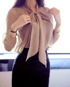 This is a great work blouse for Bigger on bottom. This big bow creates volume on top minimizing the hips.