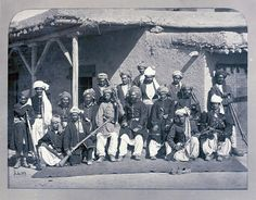 Photograph of Afghan policemen sporting long-barelled rifles, taken in Kabul, Afghanistan, by John Burke, 1879-80. Burke accompanied the British army into Afghanistan in 1878 and worked steadily in the hostile environment of Afghanistan and the North West Frontier Province, recording military and topographical scenes as well as the peoples of the country during the Second Afghan War (1878-80).