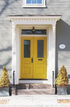 The color of the door is a C2 color called curry from Adlers Hardware in Providence. The paint brand we used was Old Holland Paints of Europe because of its beautiful glossy finish.