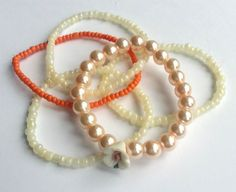 Set of 5 handmade bracelets created with seed beads and pink pearls with rose.