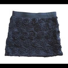 Donation Sale!! Black rosette mini skirt Last chance before donation!!! Textured stretch black skirt with all over rosettes. Large but fits like a medium. Forever 21 Skirts Mini