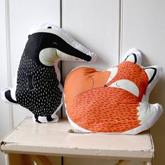 Animal cushions of lovely characters.Hand illustrated cushions featuring charming woodland creatures with the ever so dashing Rusty the Fox and busy foraging Mr Badger. Lovely additions for childrens rooms to add cosy comfort to beds and chairs or for anyone who has a soft spot for these woodland animals. Includes a duck down pad.Cushion 100% cotton. Filling 100% polyester   Badger - 19cm W 43cm H   Fox - 38cm L 36cm H