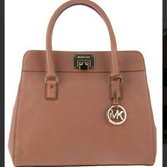 Michael Kors Astrid Satchel Beautiful brown leather Astrid Satchel. This purse is classic and timeless.   3rd picture is true color.   Leather is in great condition. Minor scuffing/scratches on hardware. Pen mark and stain on inside lining.    Bag has 1 zip outside pocket. 1 zip inside pocket, 4 open pockets, key clip.   Size approx. 13x6x9 and gold tone hardware.   Bag is missing long strap that attaches and MK hang tag.  Price already reflects flaws which are shown in last picture. Michael…