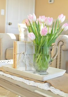 Farmhouse Decor on a budget: DIY Unbound Vintage Books Wrapped in Twine.