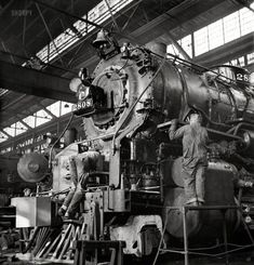 """December 1942. """"Chicago, Illinois. Locomotive under repair at the Chicago & North Western shops."""" So that's what that little step is for. Medium-format negative by Jack Delano for the Office of War Information."""