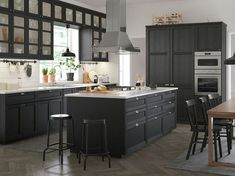 Add a taste of traditional craftsmanship to your kitchen. High quality LERHYTTAN doors in black stain are designed to stand the test of time. With its distinct traditional character and solid wood frame LERHYTTAN creates a cosy kitchen with rustic charm. Kitchen Ikea, Cosy Kitchen, Ikea Kitchen Australia, Voxtorp Ikea, Kitchen Color Palettes, Cost Of Kitchen Cabinets, Gray And White Kitchen, Cabinet Door Styles, Cabinet Colors