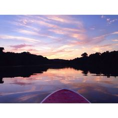 Paddle boarding in Austin, Texas at sunset.