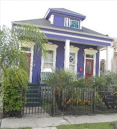 New Orleans, a shotgun double house. Why don't people all over, paint houses in such joyous colors I wonder????