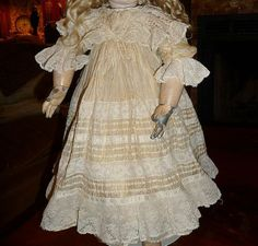 Stunning and elaborate antique silk doll dress for medium doll
