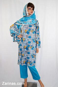 Gul Badan Women's Perahan Tunbaan.  Stylish and comfortable women's style salwar kameez, or payran tumban. Made from a soft, light weight, and floral fabric. The style fits loosely, making it a modest, knee length style. Comes with matching pants and head scarf. Typically worn by Muslim women in Afghanistan, Pakistan, and other countries in South East Asia. Available in the following sizes: small, medium, large (out of stock), and extra large. Color: Baby Blue