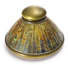 INKWELL with interior clear glass inkwell impressed TIFFANY STUDIOS/NEW YORK/28291 and with the Tiffany Glass and Decorating Company monogram, the glass inkwell with molded A mark favrile mosaic glass, patinated bronze and clear glass 3 in. (7.6 cm) high 4 1/2  in. (11.4 cm) diameterTiffany Studios | | Sotheby's