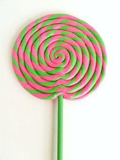 Pink and green swirl lollipop
