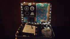 Took an old Samsonite suitcase and turned it into a band merchandise display.