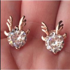 2/$15 Antlered Crystals Earrings Gorgeous and tasteful stud earrings feature small, flashy, brilliant crystals with rose-ish gold tone color antlers. Brand new and unworn. No trades, no holding, no offsite payment.  All $9 earrings are two pairs for $15     ❗️PRICE IS FIRM UNLESS BUNDLED❗️ Jewelry Earrings