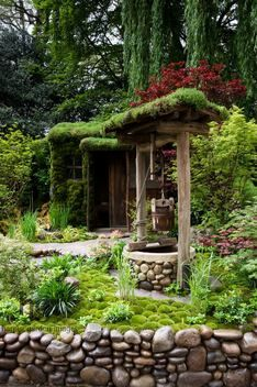 Water well with green living sedum roof Acer Leucobryum office garden building summerhouse shed hut stone pebble cobble wall Zen oriental Japanese Design: Kazuyuki Ishihara Rhs Chelsea Flower Show 2012. Satoyama Life Garden. Gold Award. Marcus Harpur
