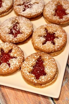 Jelly Twinkles Recipe ~ They're crisp, buttery cookies with red currant jelly sandwiched in between and then they're dusted with powdered sugar.