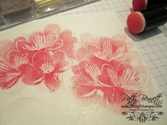 Stamp with VersaMark and then use sponge dauber and dust chalk onto design until you get the color you want. Neat!