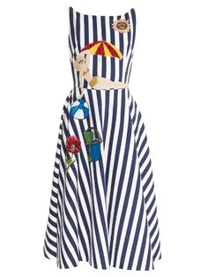 Plucked straight from the SS16 runway, this Dolce & Gabbana dress is perfect for days by the coast. It's cut from blue and white striped cotton and detailed with playful seaside appliqués, complete with sparkling sequins. Style it as the label intended: with a raffia tote and embellished sandals.