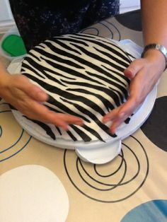 Putting the black fondant stripes on the white fondant first... will need to try